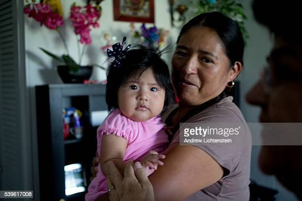 Farm worker with her new baby girl. The agricultural fields of rural Eastern North Carolina produce bountiful crops for America's food markets, as...