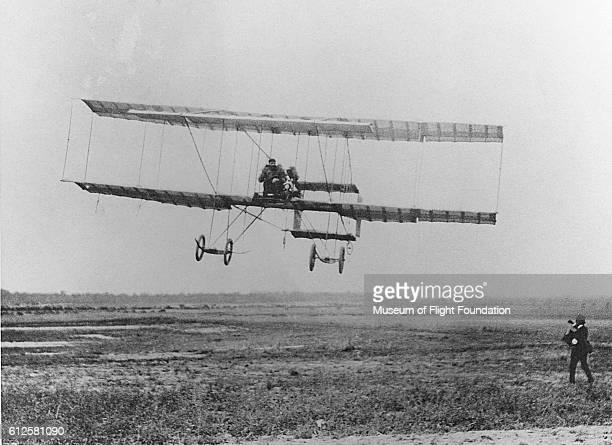 A Farman III sport/exhibition biplane takes a flight at the Rheims Airshow in France August 1909