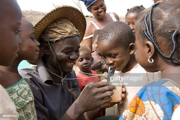 Farmer and bicycle fitter Nuru Ziblim teaches children how to filter their water with a special drinking device when visiting the farms so as to not...