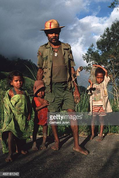 A farmer and his children near Same 110 km south of the capital Dili
