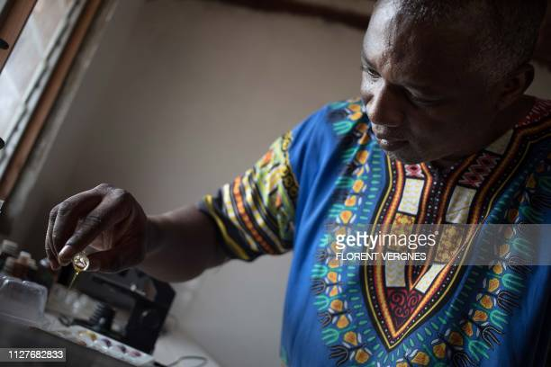 Farmer and President of the Association of Central African Farmers Pascal Bida Koyagbele pours a sample of plant oil at the laboratory of Yaka ti...