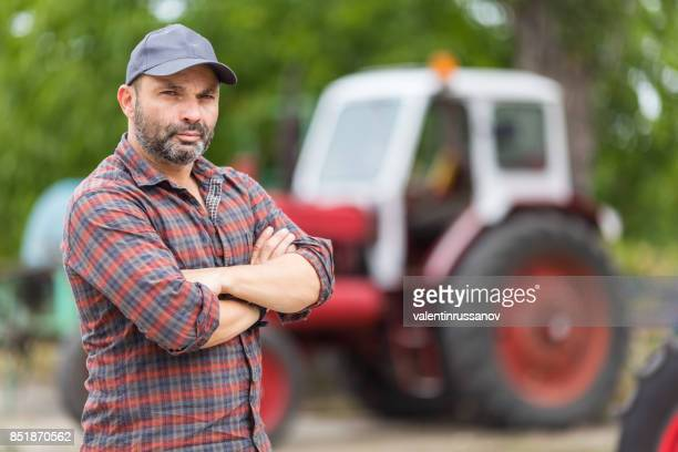 Farmer and red tractor