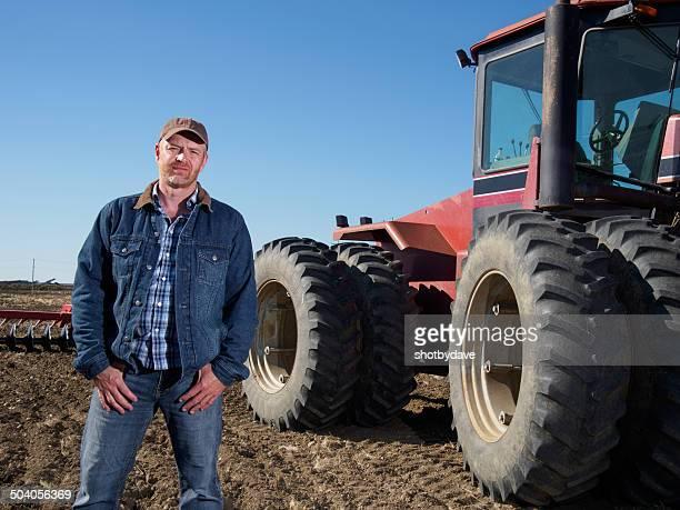 Farmer und Traktor