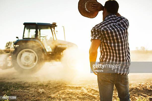 Farmer and tractor working in the fields.