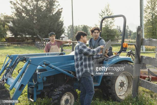 Farmer and two sons talking