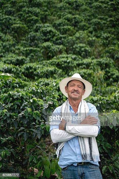 farmer at a coffee plantation - südamerika stock-fotos und bilder