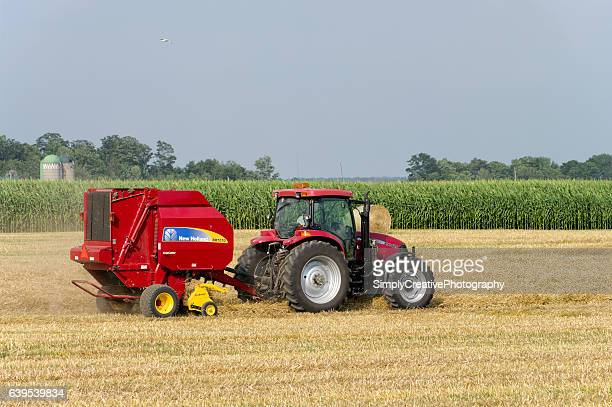 farmer baling straw - lancaster county pennsylvania stock pictures, royalty-free photos & images