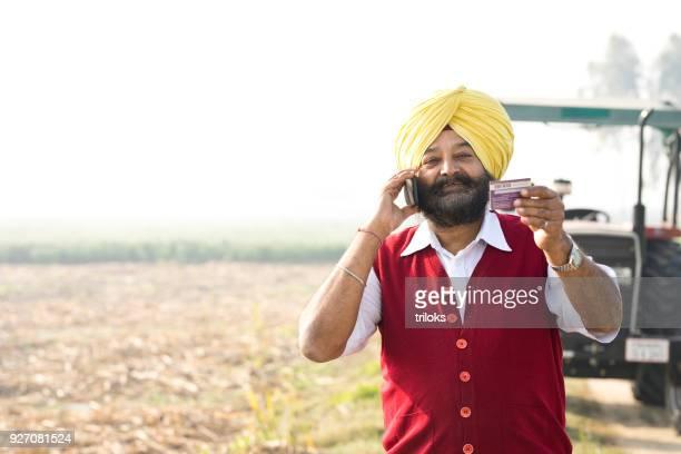 Farmer calling credit card customer support