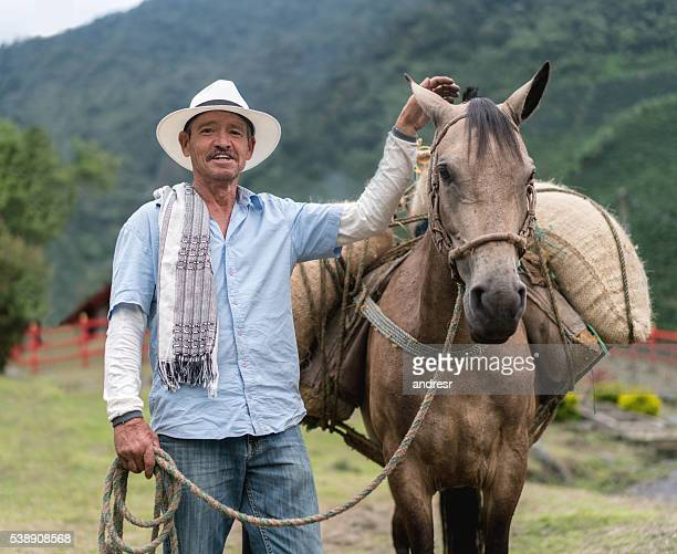 Farmer carrying crop on a horse