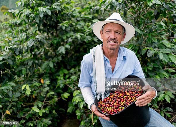 Farmer collecting coffee beans at a farm