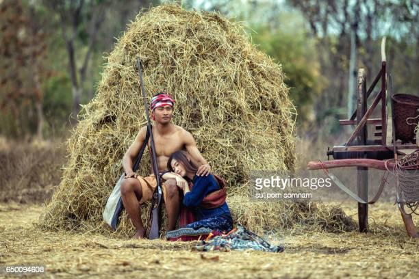 farmer couple thailand sitting near a pile - asian ox imagens e fotografias de stock