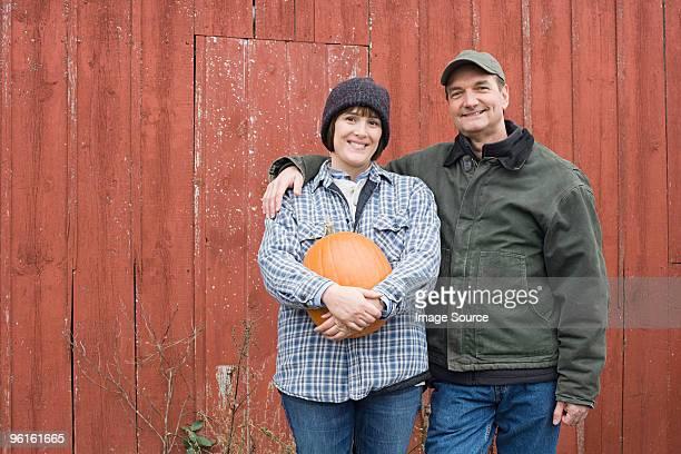 Farmer couple with pumpkin