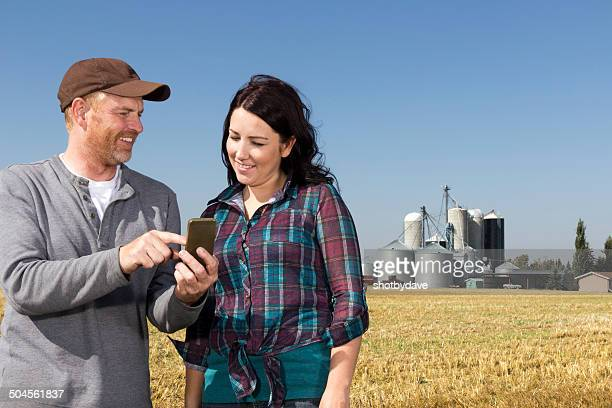 Farmer Couple with Smartphone