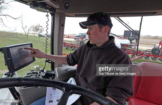 Farmer Craig Breuer programmed the GPS control unit on a Case STX 325 tractor before planting corn on fields near Marty Amundsen's Zumbrota MN. Farm...