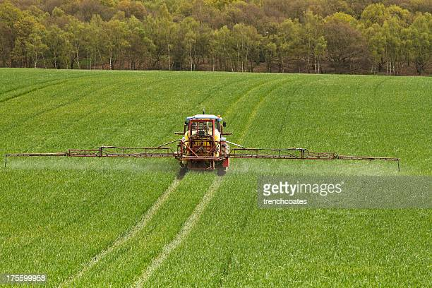 farmer crop spraying - crop sprayer stock pictures, royalty-free photos & images
