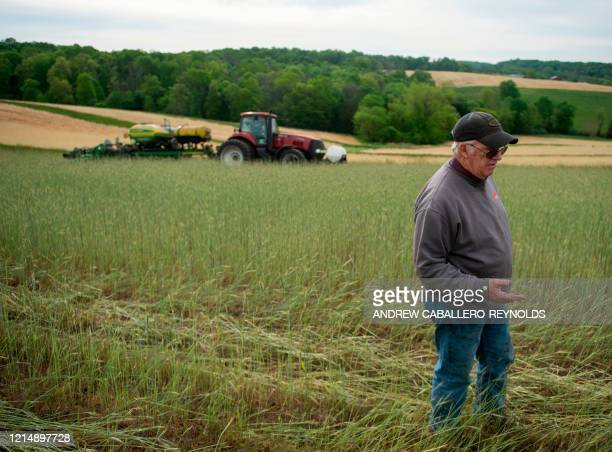 Farmer Dave Burrier speaks with AFP before planting corn in the Marvin Chapel field in Mount Airy Maryland on May 19 2020 Dave Burrier steered his...