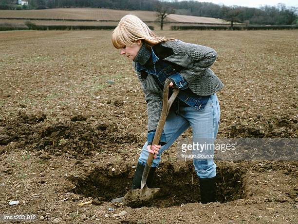 farmer digging a hole - digging stock pictures, royalty-free photos & images