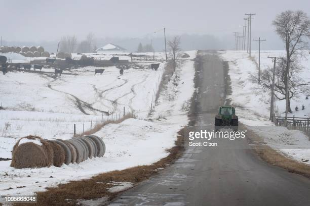 A farmer drives a tractor down a rural road on January 17 2019 near Ottawa Illinois Farmers who rely on Farm Service Agency loans to meet operating...