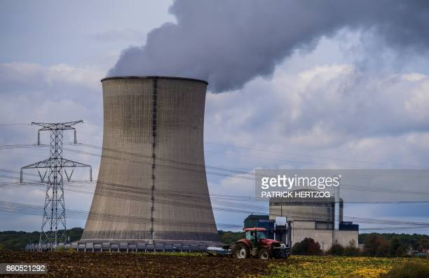 A farmer drives his tractor in front of the nuclear power plant in Cattenom eastern France on October 12 2017 after Greenpeace activists broke into...