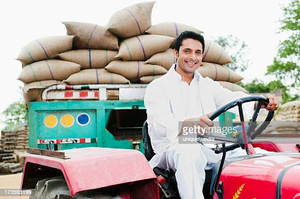 Farmer driving a loaded tractor