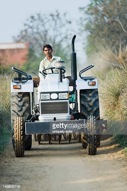 Farmer Driving A Tractor On Dirt Road Farrukh Nagar Gurgaon Haryana