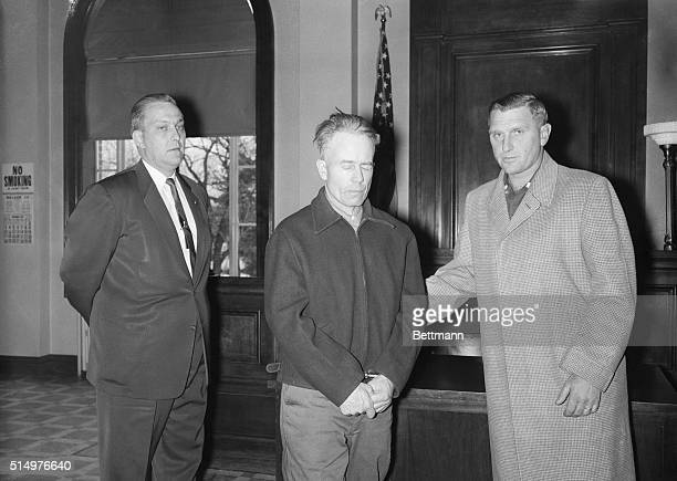 Farmer Ed Gein confessed slayer of two women stands with his Arthur Schley in the Wabsara county Court here November 21st Gein was charged with first...