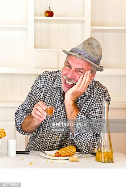 farmer enjoys a booze after hard food - tricornered hat stock photos and pictures