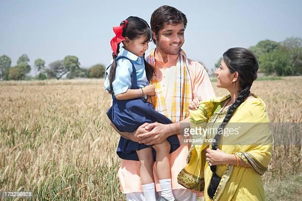 Farmer family in the field, Sohna, Haryana, India