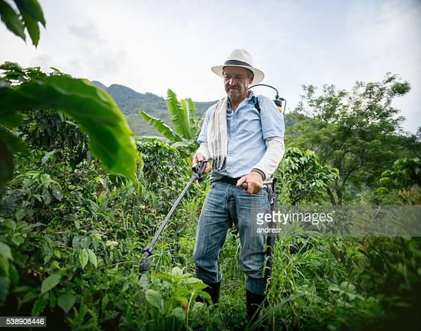 Farmer fumigating the crop