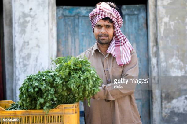 Farmer holding bunch of cilantro