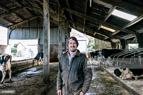 Farmer in cattle shed