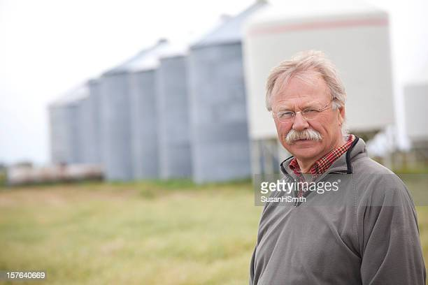 farmer in front of bins and crop - karl lagerfield bildbanksfoton och bilder