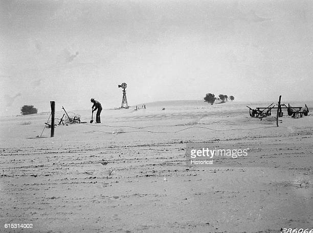 A farmer in Kansas during the Great Dust Bowl of the 1930s attempts to work formerly fertile land buried in dust