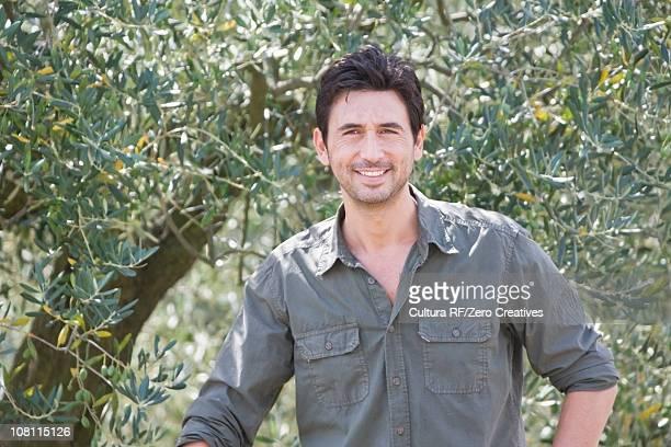 Farmer in olive yard