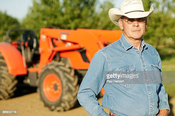farmer infront of tractor