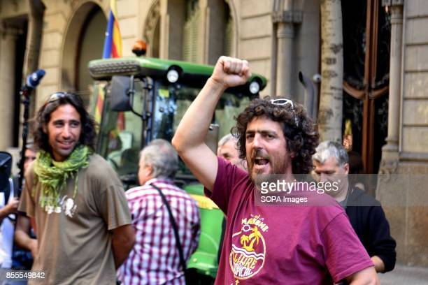 A farmer is pictured while shouting 'we want vote' during a protest of farmers in Barcelona streets Around 400 tractors called by agricultural unions...