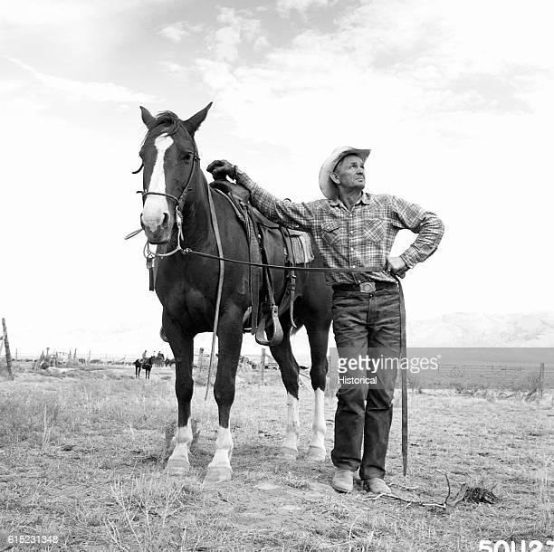 Farmer Joe Steed with his horse He is the Secretary of the Curlew Cattle and Horse Association Caribou National Forest Idaho August 1961   Location...