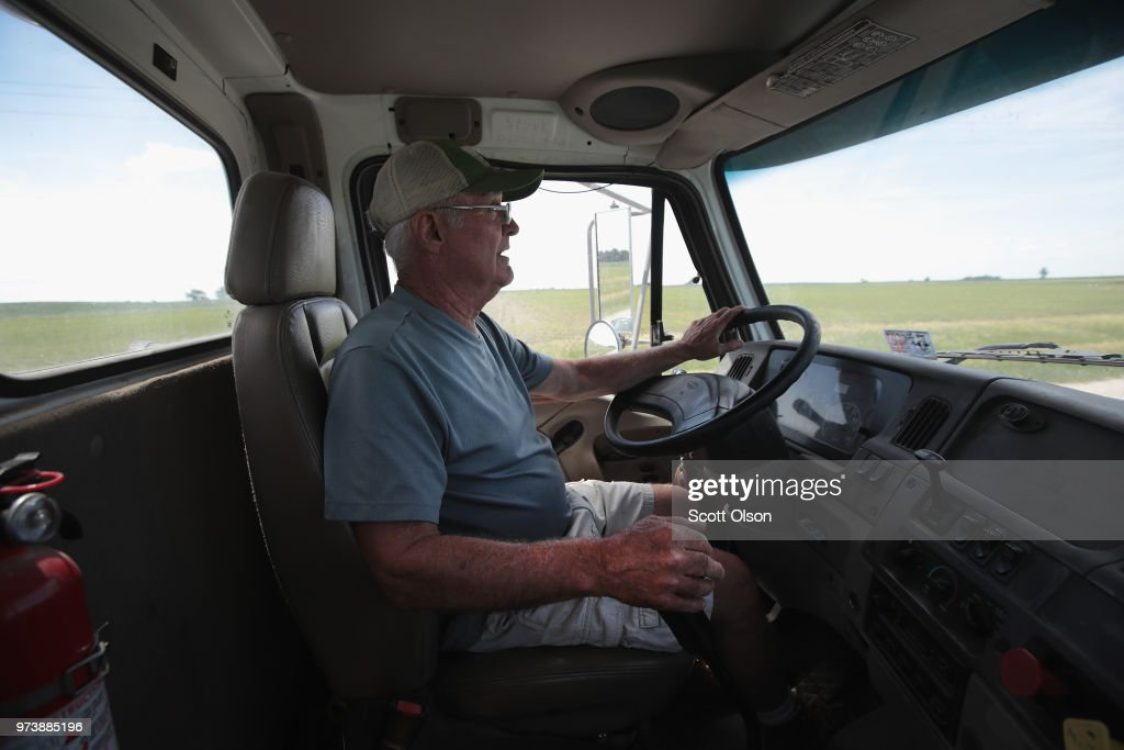 Farmer John Duffy drives a load of soybeans to the grain elevator on June 13, 2018 in Dwight, Illinois. U.S. soybean futures plunged today with renewed fears that China could hit U.S. soybeans with retaliatory tariffs if the Trump administration follows through with threatened tariffs on Chinese goods.