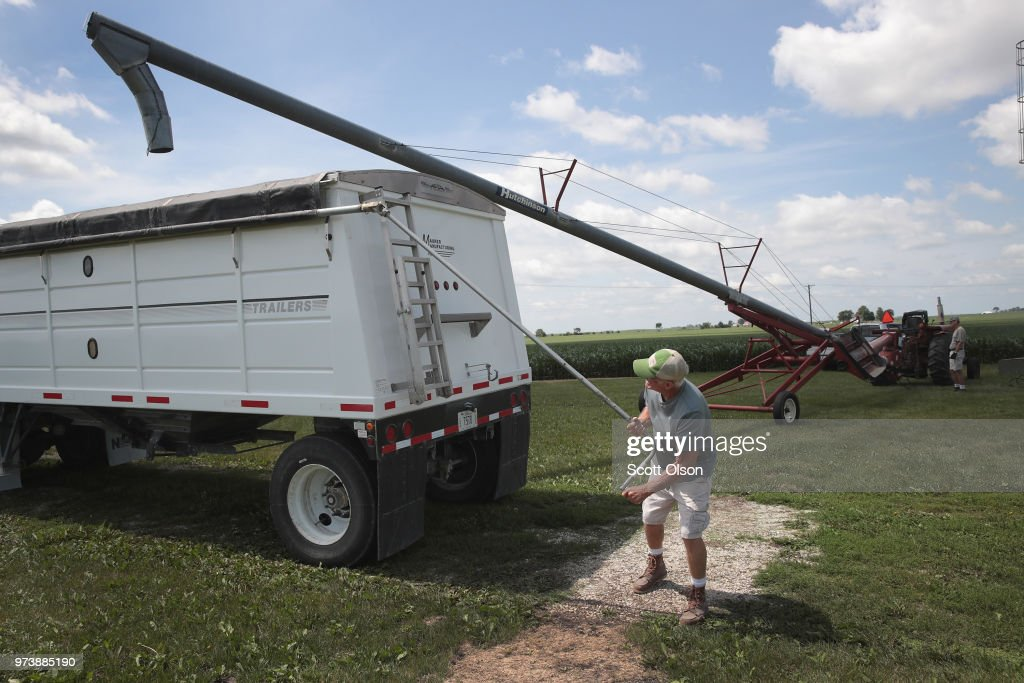Farmer John Duffy loads soybeans from his grain bin onto a truck before taking them to a grain elevator on June 13, 2018 in Dwight, Illinois. U.S. soybean futures plunged today with renewed fears that China could hit U.S. soybeans with retaliatory tariffs if the Trump administration follows through with threatened tariffs on Chinese goods.