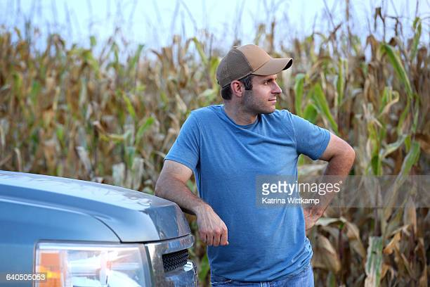 Farmer leaning on his truck
