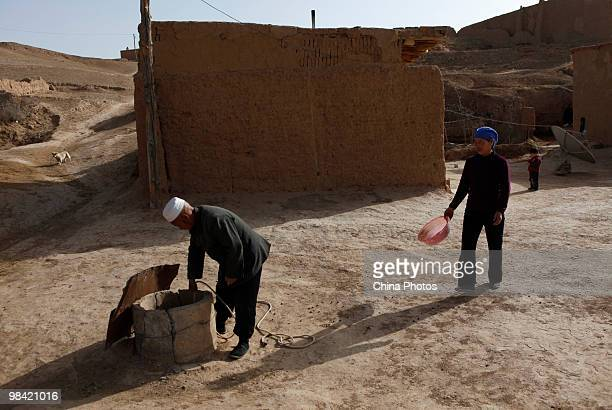 A farmer lifts up water from a cistern in his yard on March 12 2010 in Xihaigu Tongxin County of Ningxia Hui Autonomous Region north China Xihaigu is...