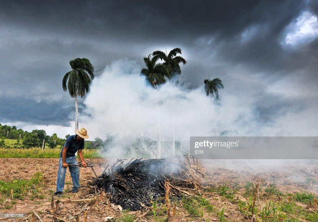 A farmer lights a bonfire near Havana on February 13, 2013.