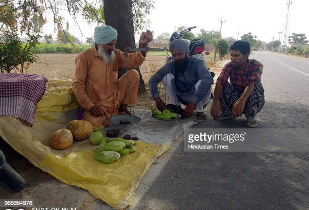 A farmer Mahender Singh who didn't prefer to take his vegetable crop to Bathinda City market selling his vegetable crop in Yatri village on June 1...