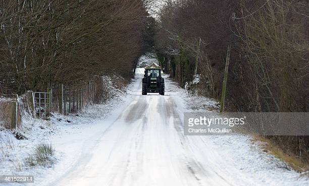 A farmer makes his way along an icy road on January 14 2015 in Antrim Northern Ireland The province experienced heavy snowfall as a cold weather...