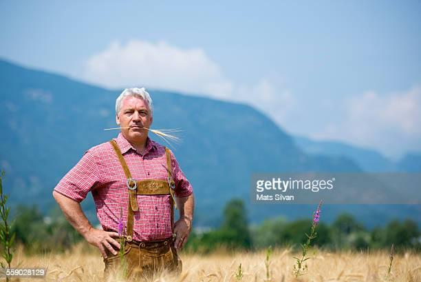 Farmer man in the wheat field