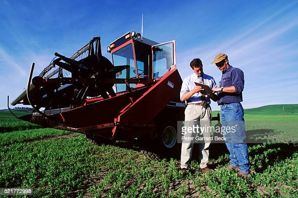 farmer meeting with businessman - agricultural machinery stock pictures, royalty-free photos & images