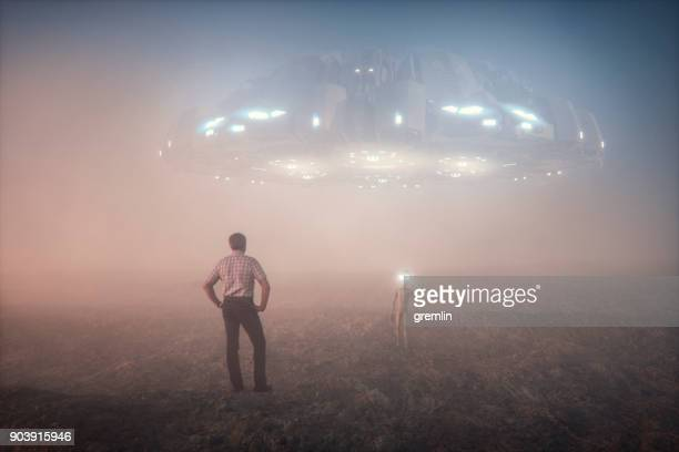 farmer meets alien - military invasion stock pictures, royalty-free photos & images