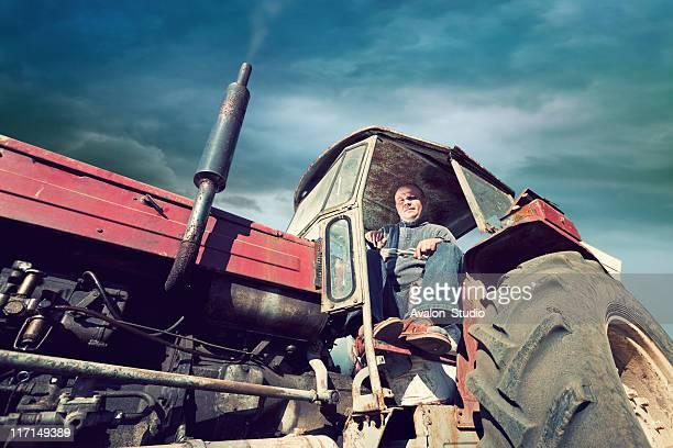 Agriculteur sur un gros Tracteur