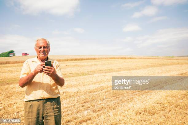 Farmer on a field with phone