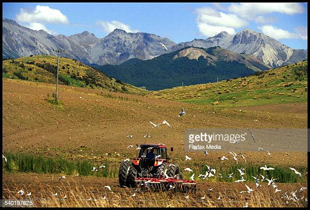 Farmer on his trackor mowing a field in rural New Zealand AFR Picture by JIM RICE